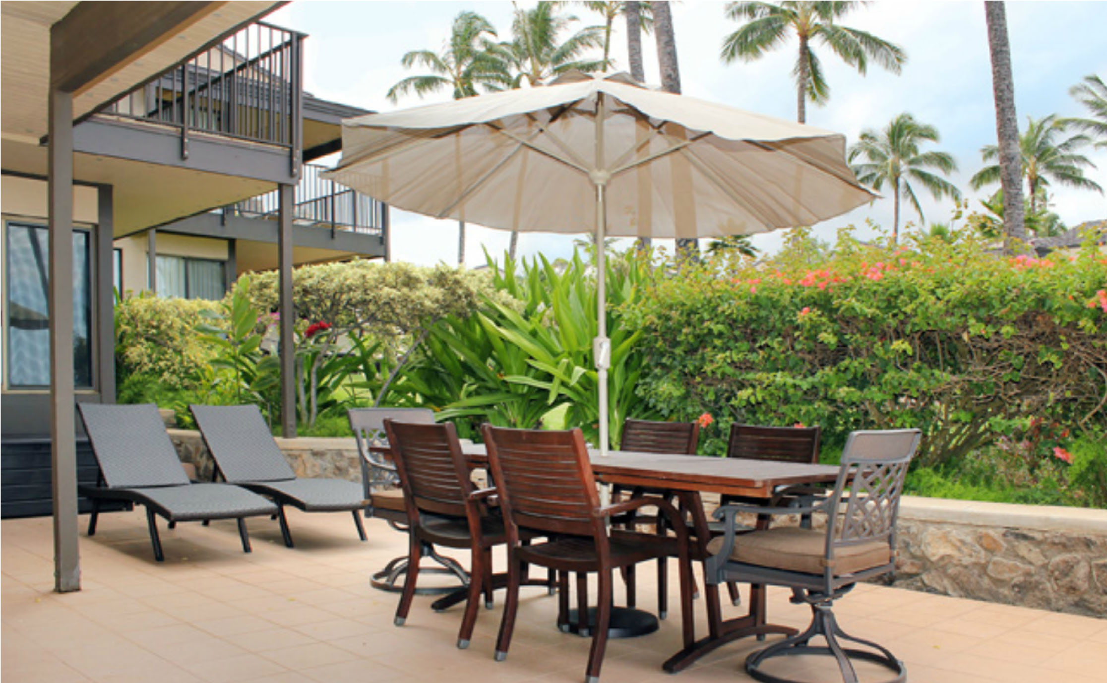 Lanai with outdoor dining table, chairs, umbrella